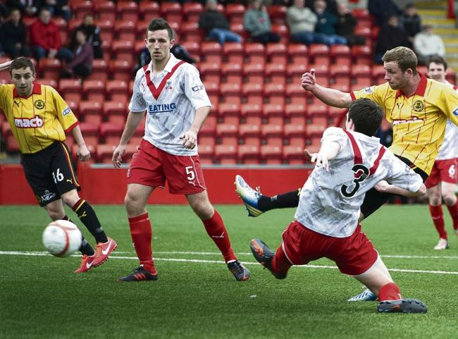 Christie Elliot drills the ball home to secure victory for Partick Thistle over Airdrie. Picture: SNS