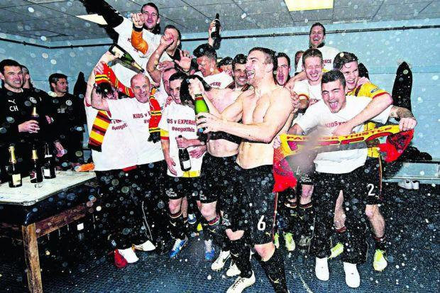 Partick players celebrate their champagne moment in the dressing room after their win at FalkirikPhotograph: SNS/Rob Casey
