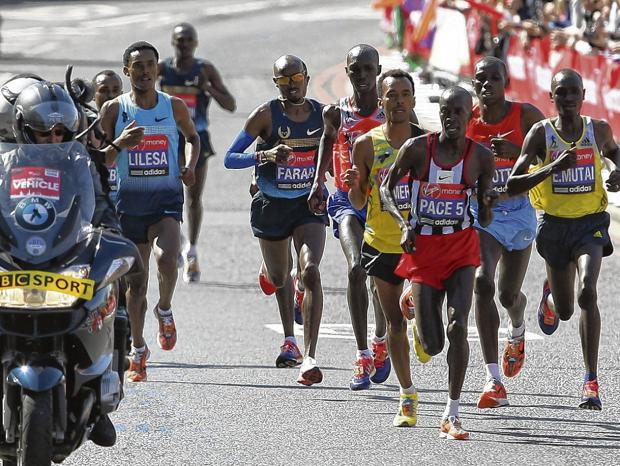 Mo Farah, centre, approaches halfway after crossing Tower Bridge