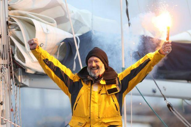 VICTORIOUS: Gerry Hughes takes the acclaim of the crowd after his sensational journey around the world in eight months. Picture: Marc Turner HAILED: Hundreds of members of the deaf community turn up to greet Gerry Hughes, who has battled rough seas on his