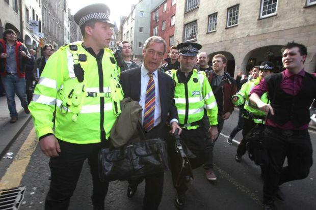 ORDEAL: Nigel Farage's press conference in a Royal Mile pub started cheerfully but quickly descended into chaos as protesters mobbed him, forcing police to intervene