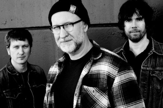 THEN AND NOW: Bob Mould, above centre, made his name more than 20 years ago when he played in Husker Du, standing on the right.