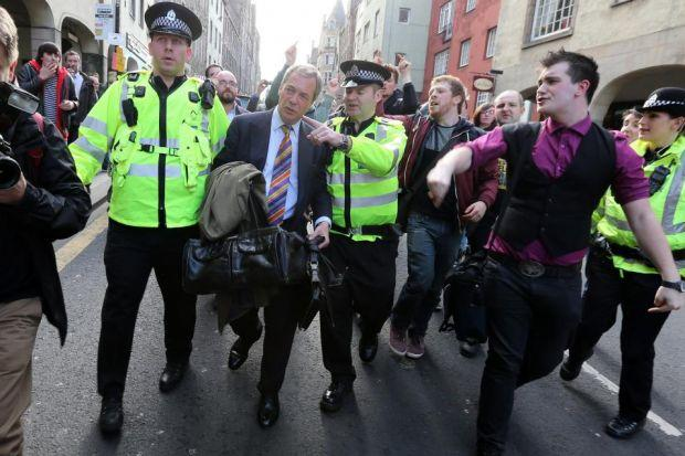 Nigel Farage is escorted by police after being heckled by anti-UKIP protesters in Edinburgh last week  Photograph:  Andrew Milligan/PA