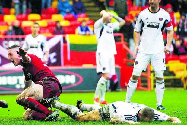 Hearts' Jamie Hamill lies prostrate after handing Aberdeen an equaliser with his own goal Photograph: SNS