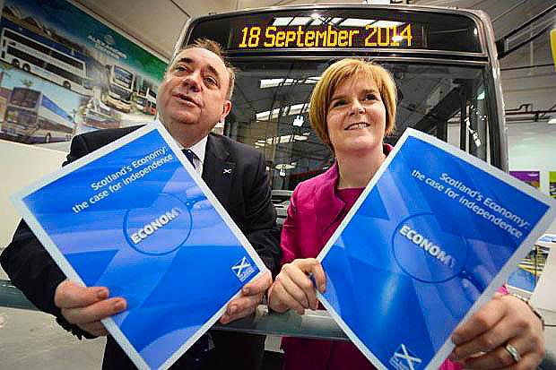 driving FORWARD: Alex Salmond and Nicola Sturgeon launched their economic report at Alexander Dennis coach builders in Falkirk. Picture: Jeff J Mitchell
