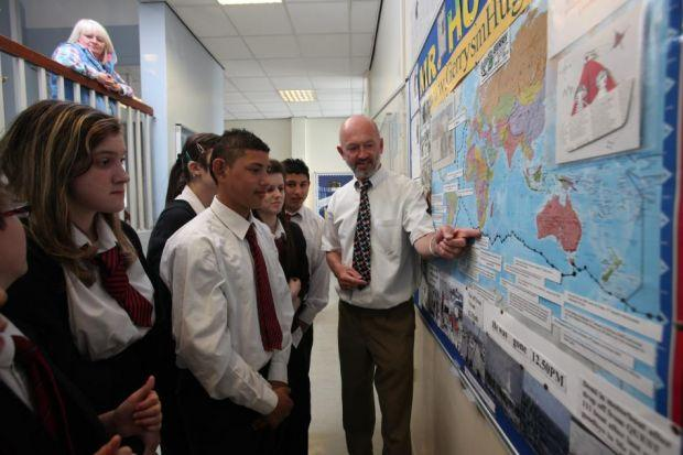 SENSE OF ADVENTURE: Gerry, left, with his wife Kay, completed his round the world voyage at Troon Marina and was met by Kay and their daughters Ashley and Nicola. CHARTING HIS JOURNEY: Gerry Hughes shows pupils at St Roch's Secondary in Glasgow, where he