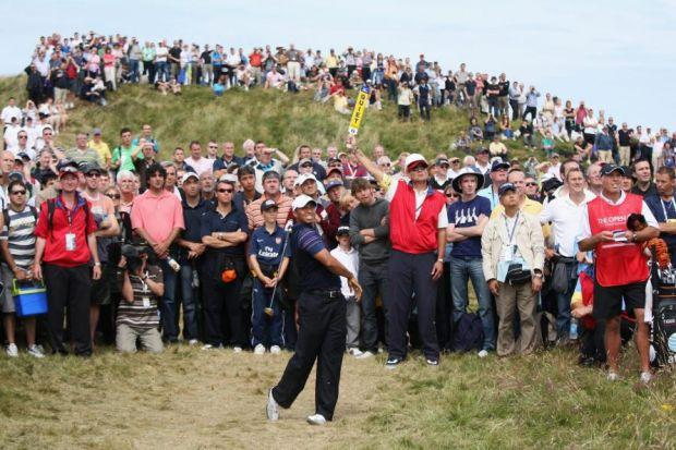 SWING KING: Tiger Woods watches his approach shot on the 17th hole at Turnberry during round one of the 2009 Open Championship on the Ailsa Course. Picture: Getty