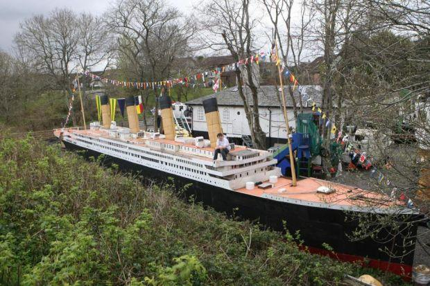 ON BOARD: Stan Fraser made an 88ft-long model of the Titanic in his back garden out of parts of a caravan, portholes he picked up at a scrap yard and items such as creels, nets and buoys. Picture: Peter Jolly