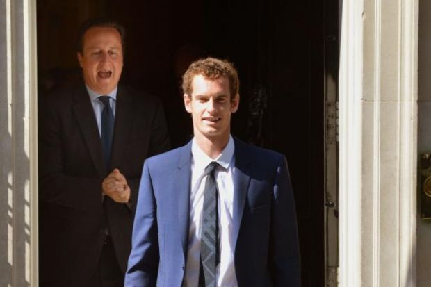 TOP MAN: Prime Minister David Cameron celebrates Andy Murray's triumph before a Downing Street reception yesterday. Picture: PA