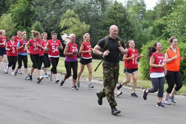WELL RUN: Recruits to Scottish Military Fitness are put through their paces by Donald McGregor in Kelvingrove Park in Glasgow. Picture: Mark Gibson