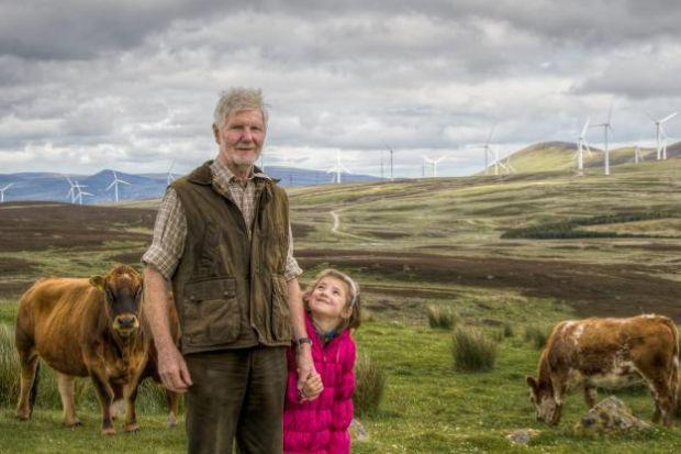OPPORTUNITIES: Investing in wind energy, like crofter Tom Robinson, pictured with grand-daughter Sinead, could offer an alternative route to returns. Picture: Gary Sutherland