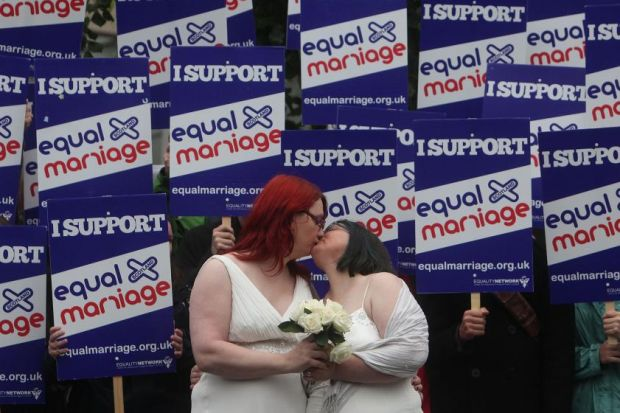 FIGHT FOR THE RIGHT: ??Newlyweds?? Jaye and Ruth Richards-Hill from Glasgow on a recent protest for equal marriage rights at the Scottish Parliament. Picture: Gordon Terris