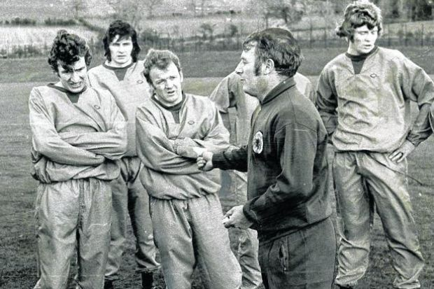 Hansen stands at the back of a group, left to right, Martin Buchan, Sandy Jardine, Billy Bremner, Willie Young and Willie Carr, listening to Scotland manager Tommy Docherty??s tactics ahead of a 1-0 win over Belgium in 1971