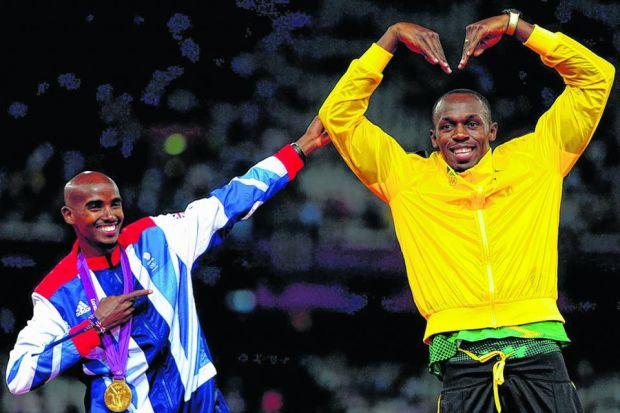Mo Farah and Usain Bolt swap their traditional victory poses at the 2012 London Olympics but should they be encouraged to race over a distance not traditionally staged? Picture: Adam Davy/PA Wire