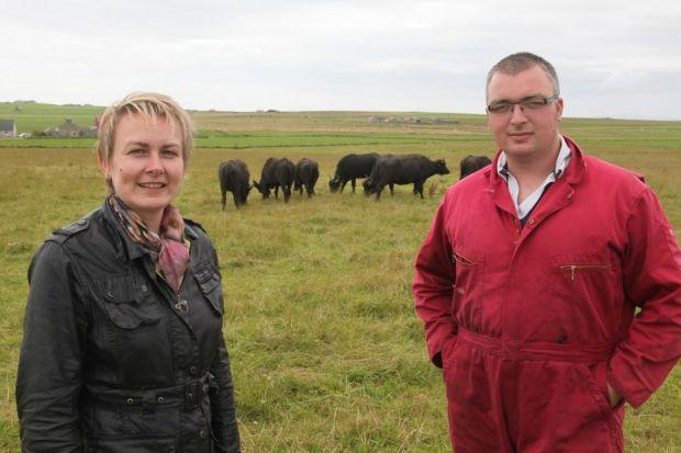 with THE HERD:  Margaret Keenan and Russell Bremner with the buffalo on Orkney. Picture: Ken Ame