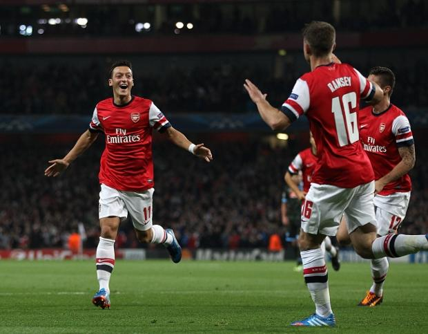 Police question Arsenal's Mesut Ozil after car hits photographer