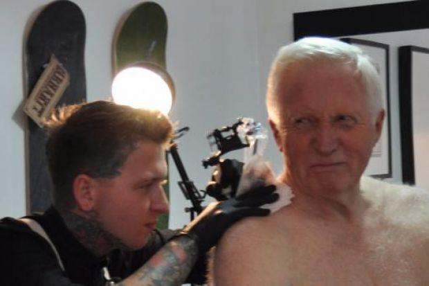 STING IN THE TALE: David Dimbleby shows his tattoo.
