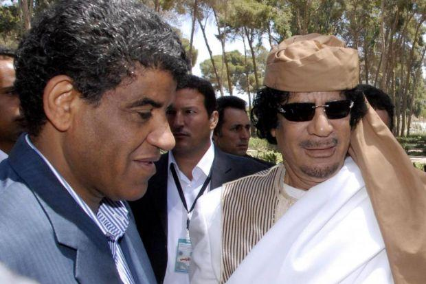 Anoud Senussi, below, is calling for her father Abdullah Senussi, above with Colonel Gaddafi, to be given a fair and public trialPhotograph: EPA
