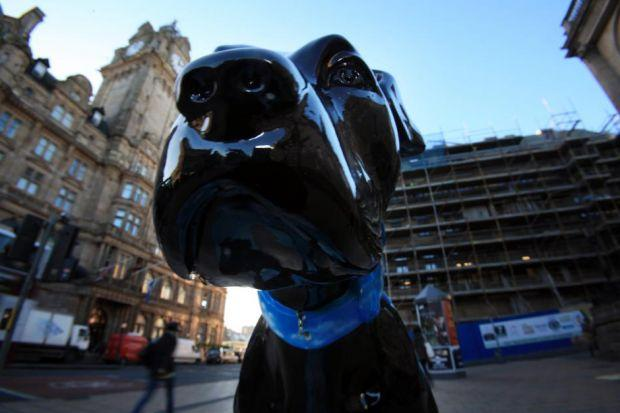 The statue of Angus the dog in Princes Street, Edinburgh, is part of a campaign by mental health charity Sane	Photograph: Steve Cox