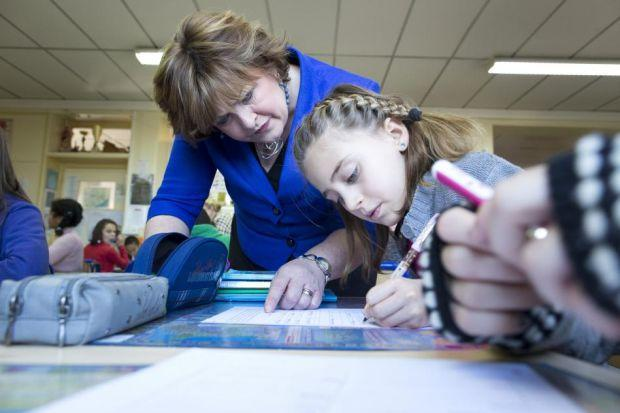 SCHOOL VISIT: Scottish Culture Secretary Fiona Hyslop follows the work of one pupil during her visit to Ecole Marbeau in Paris.