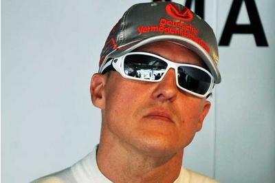 Michael Schumacher's wife says former F1 champion is slowly improving