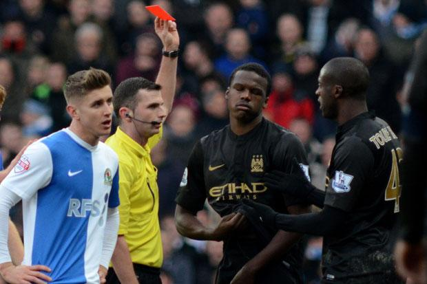 Manchester City's Dedryck Boyata (centre) receives a red card during the FA Cup Third Round