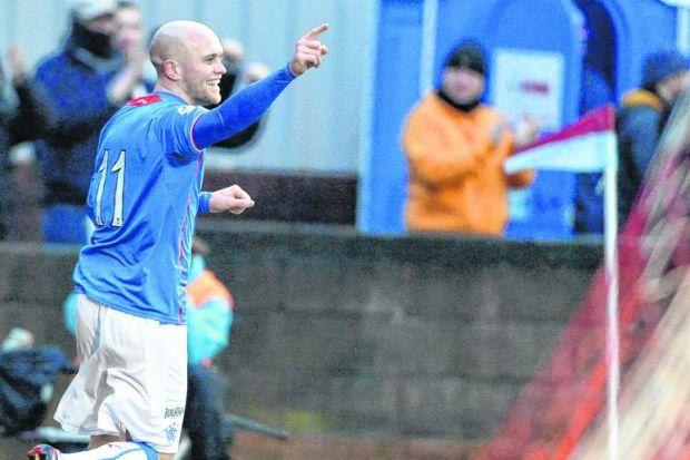Nicky Law turns to celebrate after giving Rangers the lead late in the first half. Picture: SNS