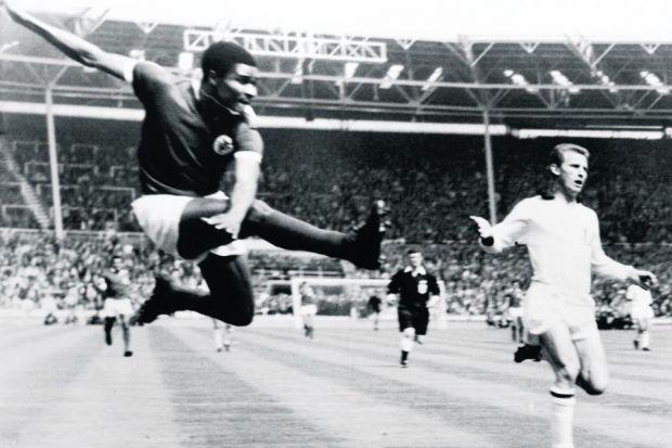 Eusebio takes a flying kick to score the first goal of the match, 18 minutes into the European Cup final against AC Milan at Wembley in May 1963, although Milan went on to win the match 2-1. Picture: Getty Images