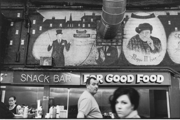 Besides landscapes, Elliott Erwitt shot city scenes such as this snack bar at the Barras market in Glasgow during his 38 days photographing Scotland