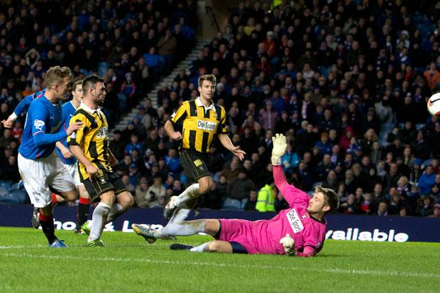 Rangers' Dean Shiels (hidden) scores the opening goal during the Scottish League One match
