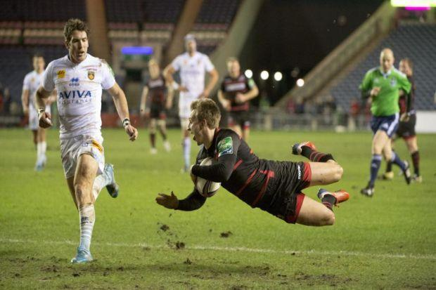 Tom Brown flies over the line to score Edinburgh's first try against Perpignan at Murrayfield                                          Photograph: SNS
