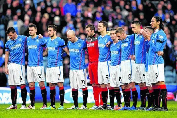 Rangers players during a minute's silence for Ian Redford at Ibrox on Saturday. Picture: SNS