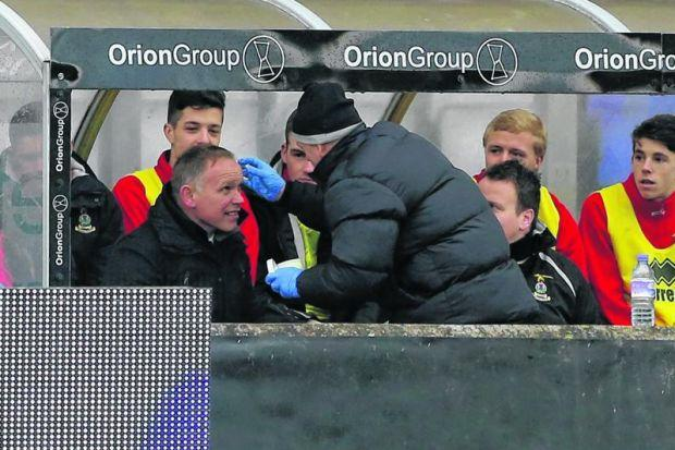 Inverness Caledonian Thistle manager John Hughes receives treatment for a head injury during his side's match against Dundee United at the Tulloch Caledonian Stadium. Picture: Andrew Milligan/PA Wire