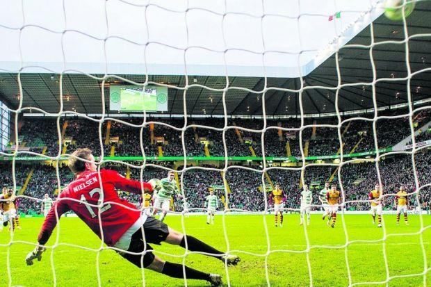 Kris Commons nets his second goal of the afternoon as his penalty sails high into Gunnar Nielsen's net Photograph: SNS
