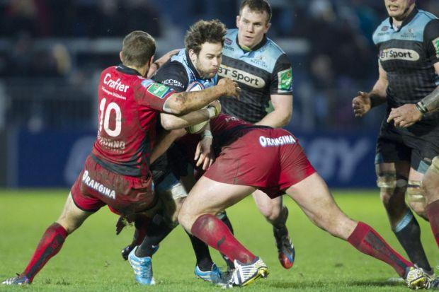 Warriors' Ruaridh Jackson runs into trouble against Toulon Photograph: SNS