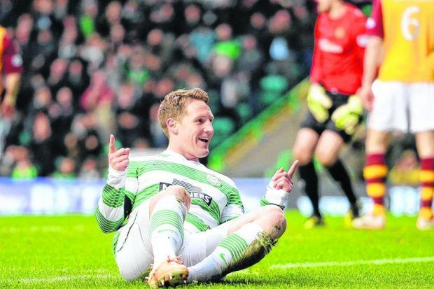With five minutes of the match played, Celtic attacking midfielder Kris Commons celebrates scoring the opening goal of the game against Motherwell. Picture: SNS