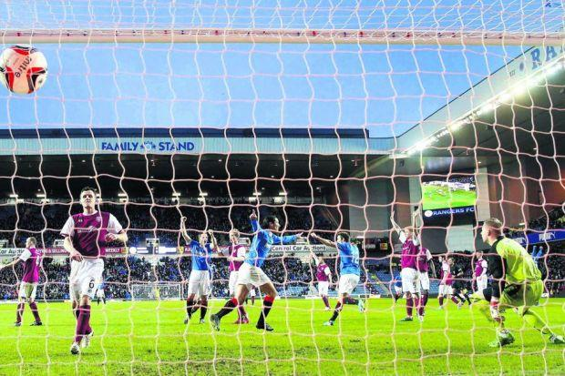 Lee McCulloch's penalty flies into the back of the net to earn victory for a Rangers side that were twice behind Photograph: PA