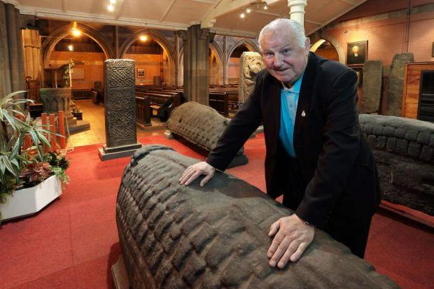 ROLLING STONE: James McGhee, the keeper of the 11th Century gravestone at Govan Old Church. Picture: Findlay/Alamy