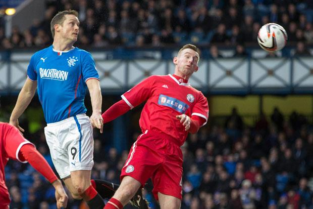 Rangers' Jon Daly (left) scores his sides second goal