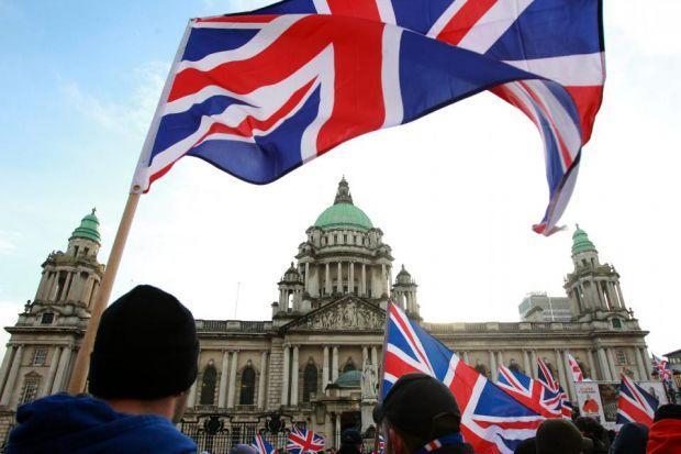 The UK flag is a potent symbol for Ulster Protestants, who show their feelings with it outside Belfast City Hall, left, while former and current Ulster Unionist Party chiefs David Trimble and Mike Nesbitt, above, are more concerned by Scots nationalism's