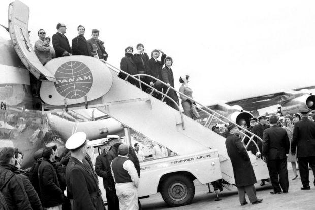 Above: The Beatles with Ed SullivanLeft: The band greet fans as they arrive in the USA for the first time