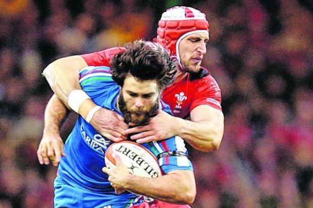 Dan Lydiate and Luke Charteris combine to stop Italy's Luke McLean in his tracks. Picture: PA