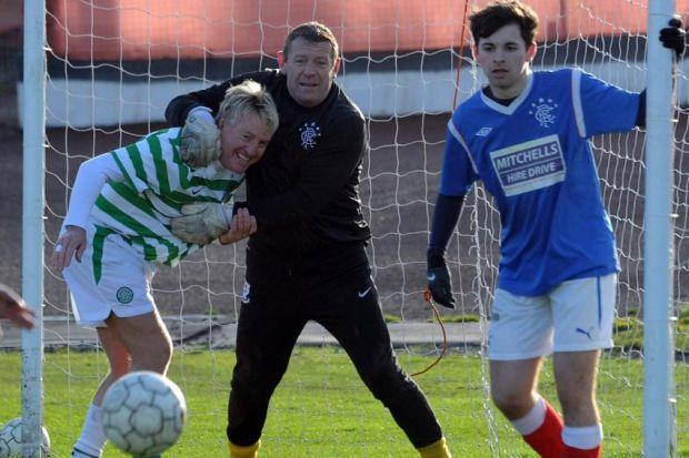 LEGENDS: Celtic's Frank McAvennie and Rangers Andy Goram roll back the years on the pitch. Picture: Nick Ponty