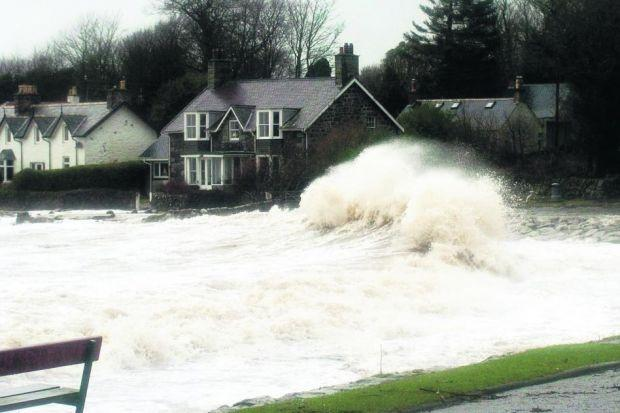 DELUGE: The Solway village of Rockliffe was cut off at high tide yesterday with huge waves closing the road and leaving debris. Picture: Bob Geddes/Solway Press