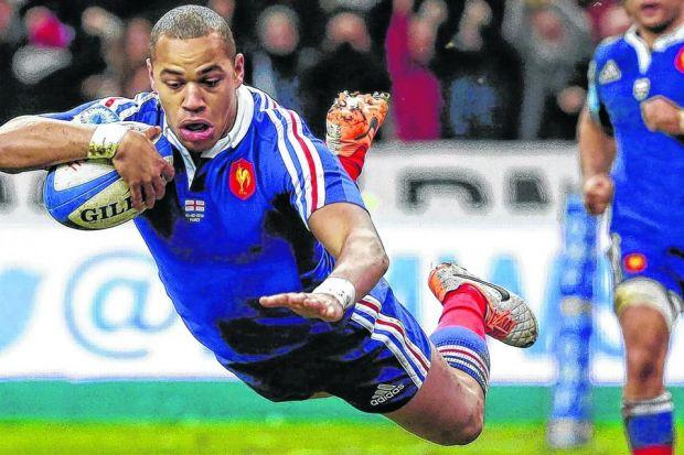 flyer: the excellent Gael Fickou dives over for the try which was converted to give France victory. Picture: EPA