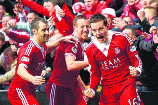 Peter Pawlett, right, celebrates with Adam Rooney, centre, and Niall McGinn after scoring his side's second goal as Aberdeen at last reach a final. Picture: SNS