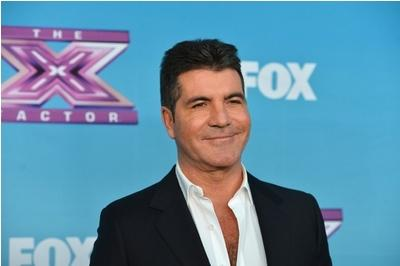 Close shave for TV mogul Cowell as knife-throwing act on BGT goes wrong