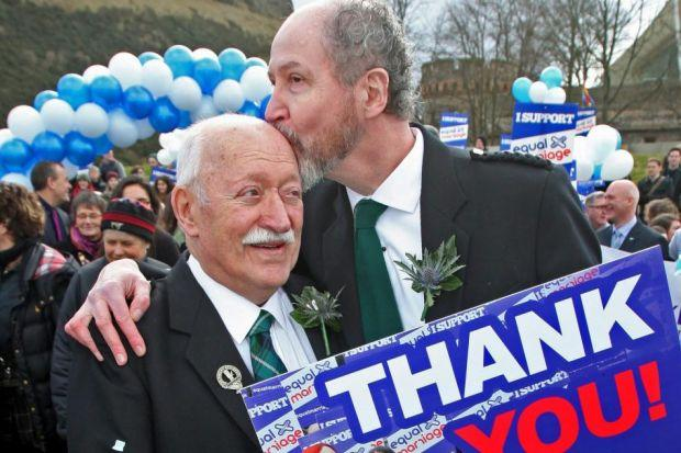 COMMITMENT: Larry Lamont, left, and Jerry Slater celebrated outside the Scottish Parliament as the Marriage and Civil Partnership ­(Scotland) Bill was passed. Picture: Gordon Terris