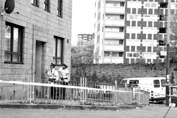 MURDER SCENE: The flats in Glasgow's Maryhill where Frank McPhie was shot by an assassin.