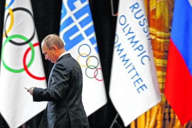 Putin addresses the 126th session of the IOC ahead of the start of the Games.